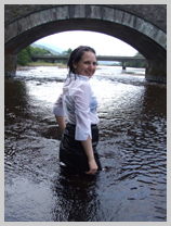 Felicity drenches a smart worker's uniform at the bridge featuring Felicity, the Serving Wench